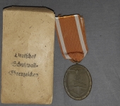 German West Wall Medal and Paper Envelope